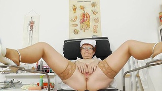 Head nurse practitioner in glasses tantalise her pussy Thumbnail