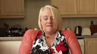 British mature blonde granny Carol fingers her wet pussy Thumbnail